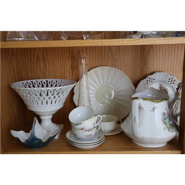 "Shelf lot of collectibles including Limoge lidded casserole and large 20"" oval platter, Belleek plat"