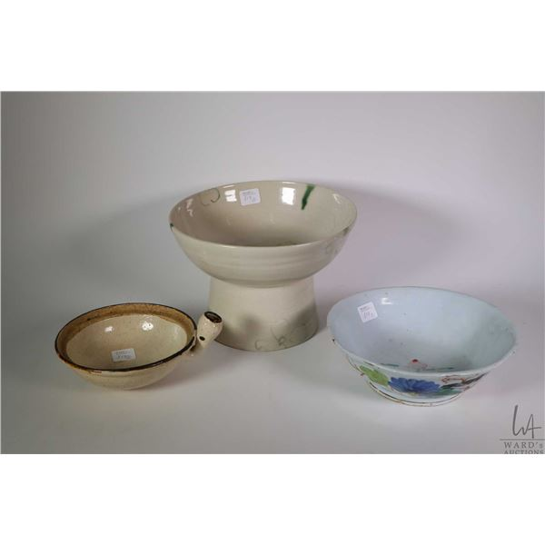 """Three pieces of Oriental pottery including 6"""" footed dish, handpainted and hand thrown bowl and a gl"""