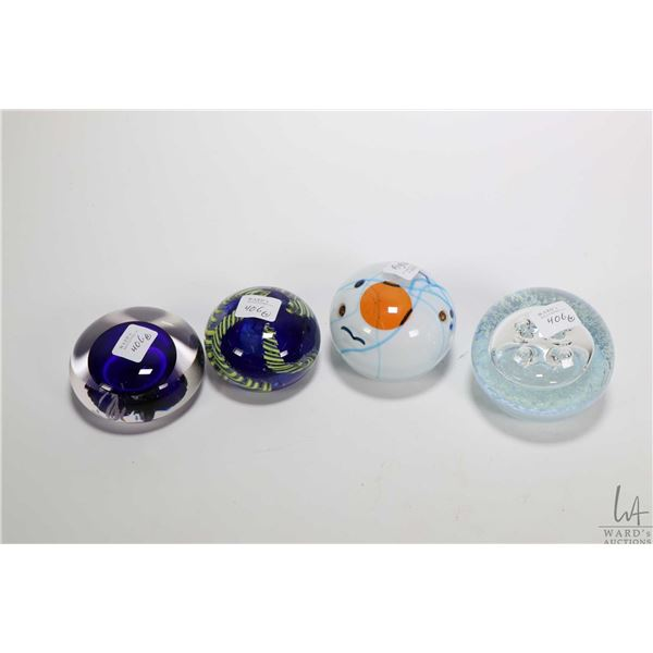 Four collectible glass paperweights including cased glass pieces, glow in the dark etc. ,    two wit