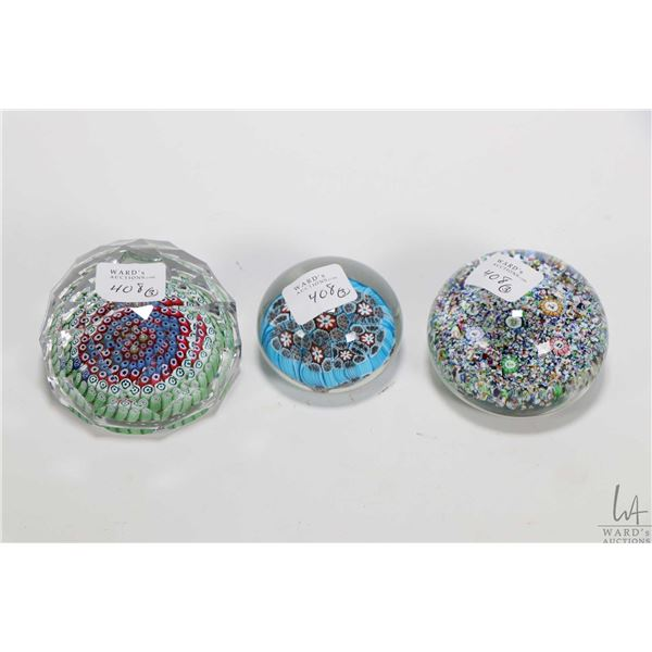 Three collectible millefiori glass paperweights