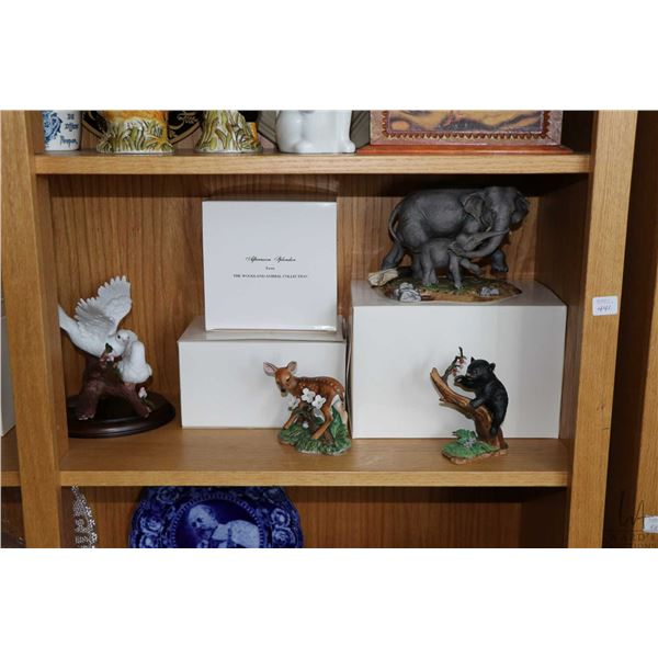 Shelf lot of collectible Lenox bisque figurines including Black Bear, Elephants, White Tail Deer, Gr