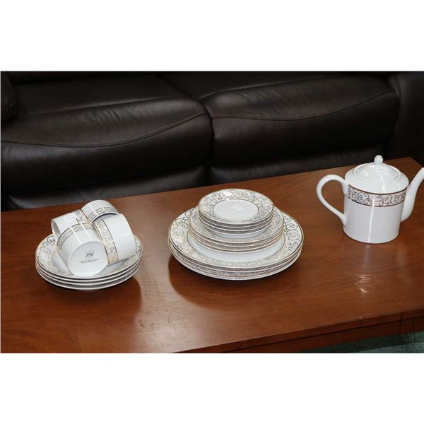 """Selection of gold and white """"Holiday Joy"""" dinnerware with settings for four of dinner plates, side p"""