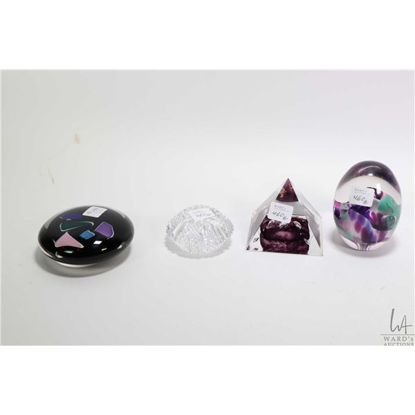 Four collectible glass paperweights including two artist signed, a crystal weight and a pyramid