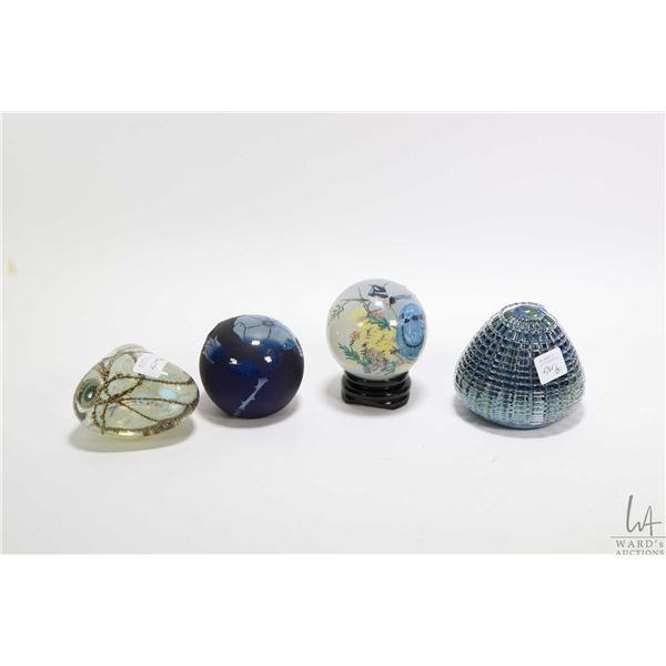 Three collectible glass paperweights including two artist signed plus and a bird motif reverse paint