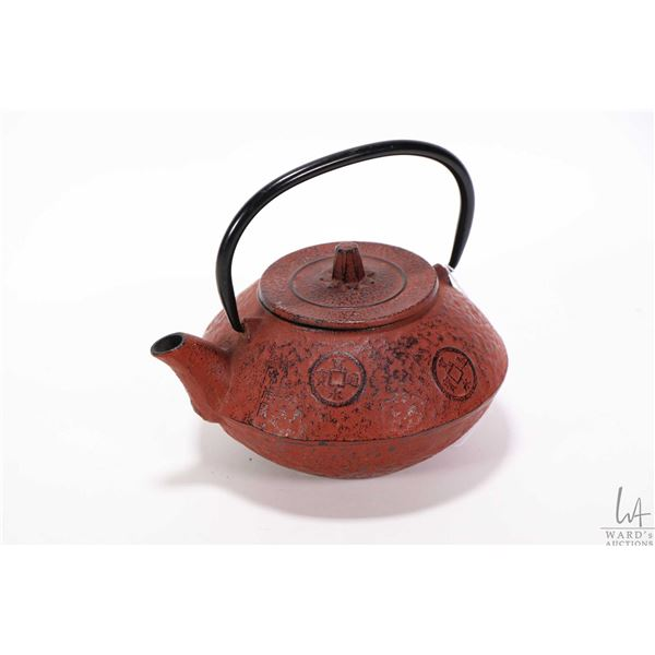 Japanese red cast iron teapot decorated in Japanese characters