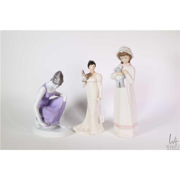 "Three porcelain figurines including Franklin Porcelain ""Charlotte"" 7 1/2"" in height, a Nadal little"