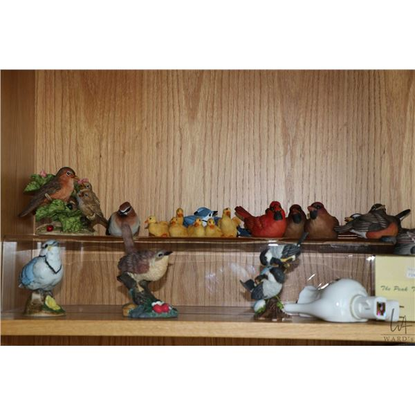 Shelf lot of animal collectibles including Charming Tails mice, Peak time collection animals, plus a