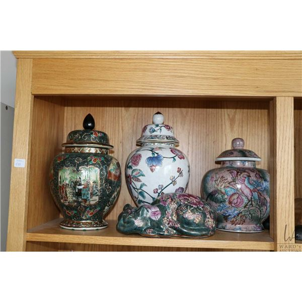 Shelf lot of collectible ginger jars including Satsuma style, handpainted floral jars, a lidded dres