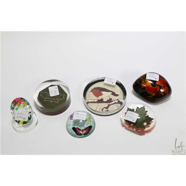 Six collectible paperweights including two acrylic maple leaf themed, a Buffy Robinson batik painted