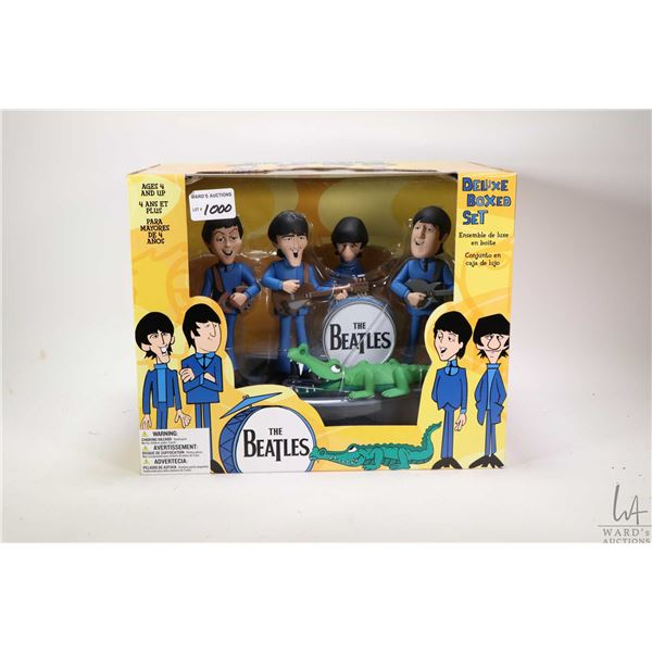 Deluxe boxed set of Beatles figurines including all four band members with instruments by McFarlane