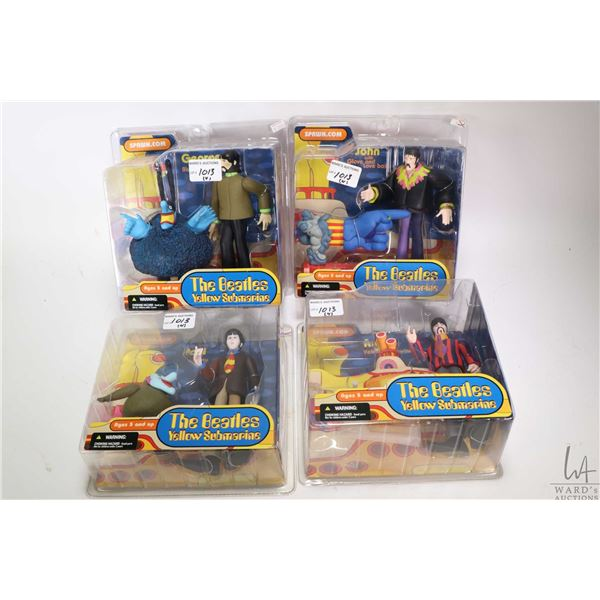 Four factory sealed Yellow Submarine Beatles figurines, each with additional figure from McFarlane T
