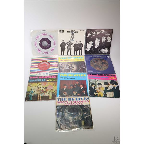 """Ten 45 rpm Beatles singles including """"Timeless II 1/2"""", """"The Beatles Around the World"""" on pictorial"""