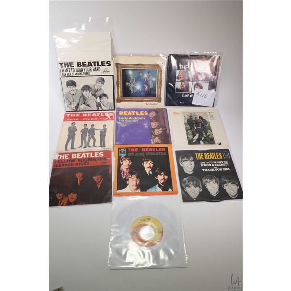 """Ten 45 rpm Beatles singles including """"Strawberry Fields"""", """"She Loves You"""" with original retailers st"""