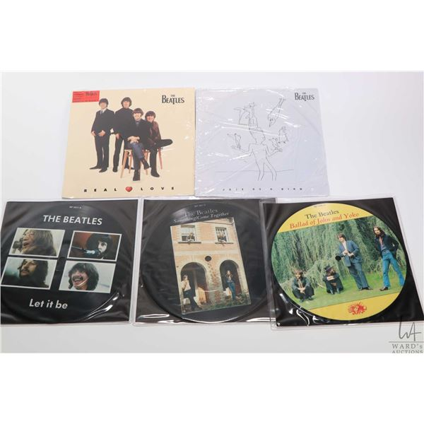 """Five 45 rpm Beatles singles including three picture discs """"Something"""", """"Free as a Bird"""", """"Let It Be"""""""