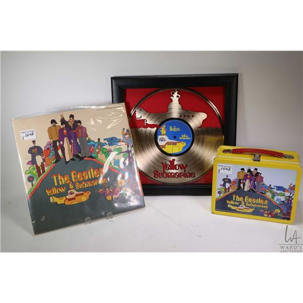 Three Beatles Yellow Submarine collectibles including LP manufactured and distributed in Canada, app