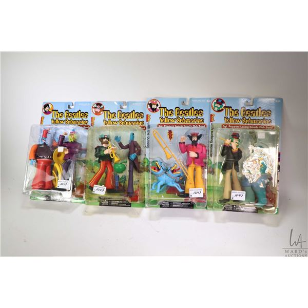 Four factory sealed Yellow Submarine/ Sgt. Peppers Lonely Heart Club Band figurines, each with addit