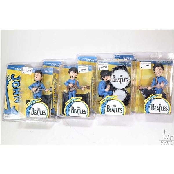 The Beatles figurines including all four band members by McFarlane Toys, all new in package