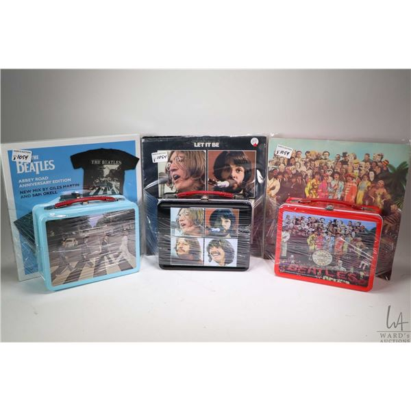 Three Beatles LPs including Let it Be, Sgt. Peppers and an anniversary edition of Abbey Road, each w