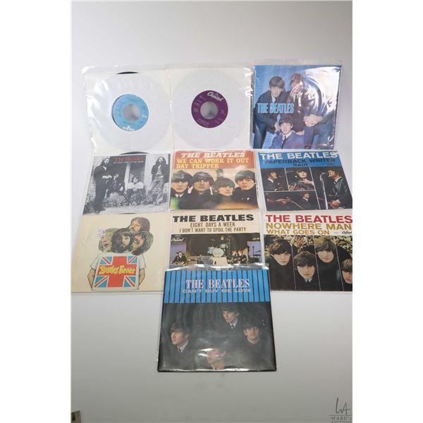 "Ten 45 rpm Beatles singles including ""Hard Days Night"", ""Yesterday"", ""I Feel Fine"", ""Paperback Write"