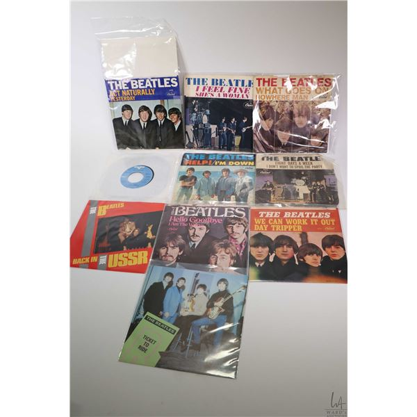 Ten 45 rpm Beatles singles including Eight Days A Week, Help, I Feel Fine, Ticket To Ride, You Can W
