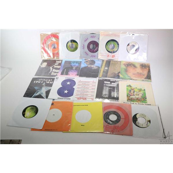 Twenty 45 rpm singles including Paul McCartney, John Lennon, Ringo Starr, all appear to be solo proj