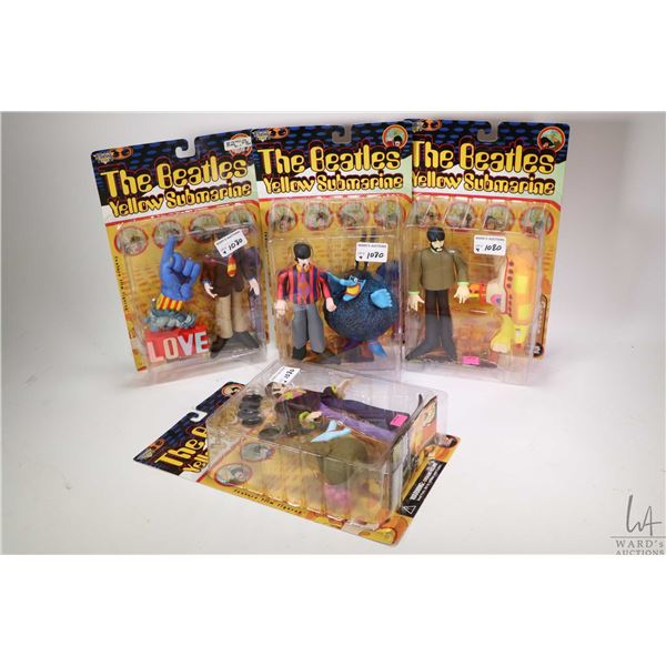 The Beatles figurines including all four band members from the Yellow Submarine Series, each with an