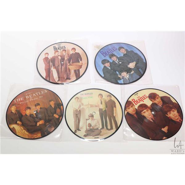 "Five 45 rpm Beatles picture disc singles including ""Please, Please Me"", ""Love Me Do"" etc. , all appe"