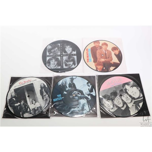 """Five 45 rpm Beatles picture disc singles including """"She Loves You"""", """"Hello Goodbye"""", """"Hey Jude"""" etc."""