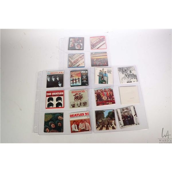 Sixteen never opened packages of Beatles miniature album collection album cover with chewing gum rec
