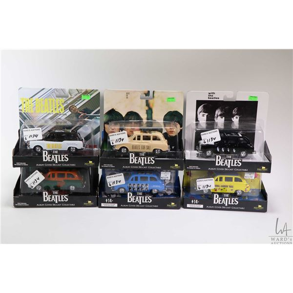 """Six new in package die cast Beatles cars including """"Rubber Soul"""", ?Magical Mystery Tour"""" etc."""
