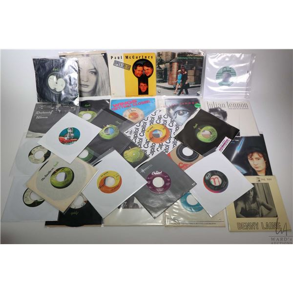 Large selection of vintage 45 rpm singles including Wings, Julian Lennon, Bad Finger, The Everly Bro