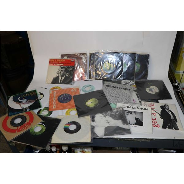 Selection of vintage 45 rpm singles including Beatles, Mary Hopkins, Peter and Gordon, Paul McCartne