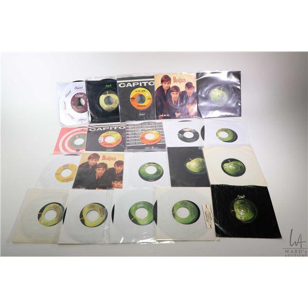 "Twenty Beatles 45 rpms ""She Loves You"", ""Can't Buy Me Love"", "" All My Loving"" etc. Including domesti"