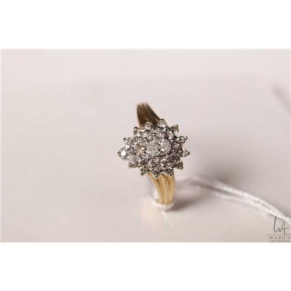 14kt yellow gold and diamond ring set with pear shaped center diamond and 24 accent diamonds, size 6