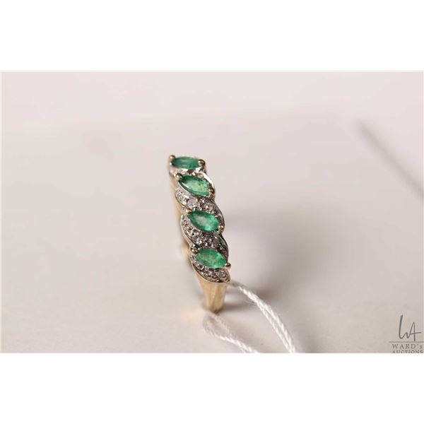 10kt yellow gold and four stone emerald set ring with diamond accents, size 6.25