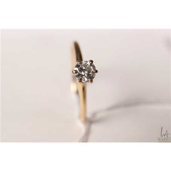 14kt yellow gold and diamond solitaire ring set with estimated .40ct brilliant white diamond, size 9