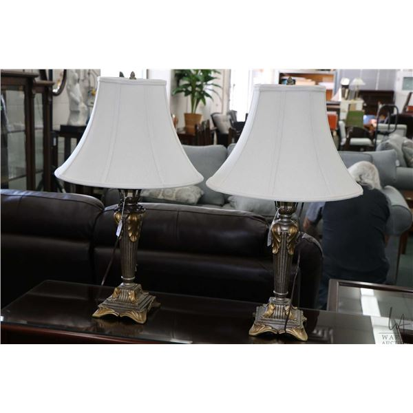 Trio of matching lamps, Romanesque in styling including two table lamps and a floor lamp. Note: Not