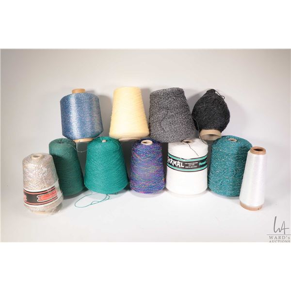 Eleven partial cones of knitting machine/ hand knitting yarn including Black Tweed, half cone of var