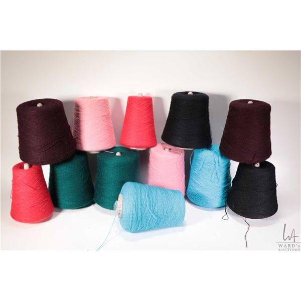 Ten full or near full cones of knitting machine/ hand knitting yarn including two Newry Spindlecraft