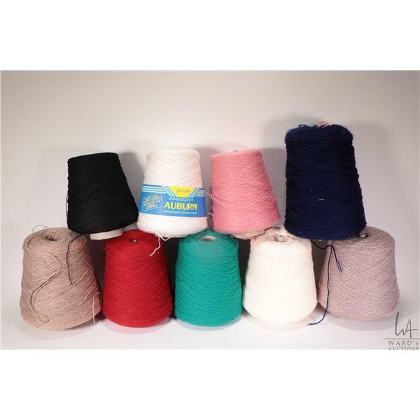 Nine full or near full cones of knitting machine/ hand knitting yarn including Christmas red, Newry