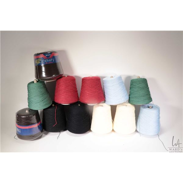 Twelve full or near full cones of knitting machine / hand knitting yarn including two cones of Varsi