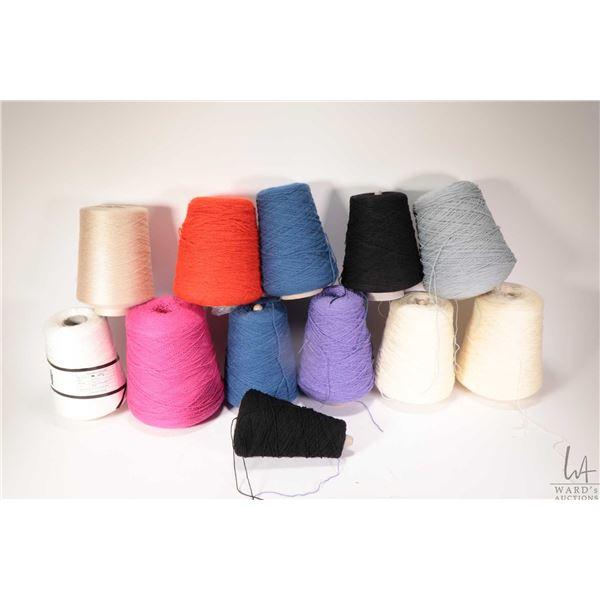Twelve partial cones of knitting machine/ hand knitting yarn including near full Laura Barbie Pink 2