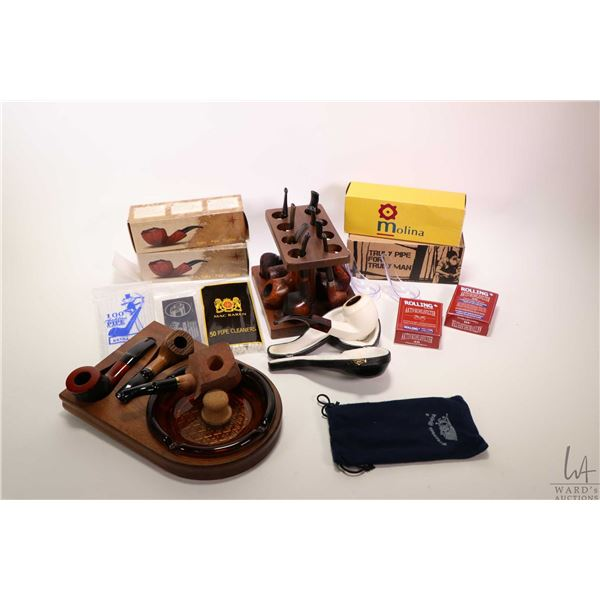 Selection of collectible pipes and pipe supplies including Molina, Fajka, Meerschaum etc. plus pipe