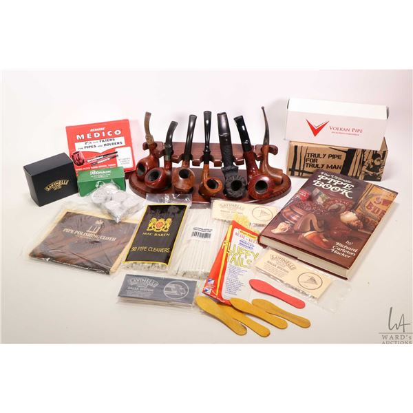 Selection of collectible pipes and pipe supplies including Volkan Pipe, Danish Sovereign, Jeantet wi