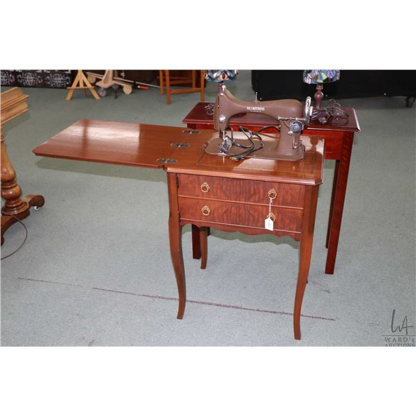 """Walnut cased """"Seamstress"""" National Sewing Machine Co. Model B, with knee controlled switch, not test"""