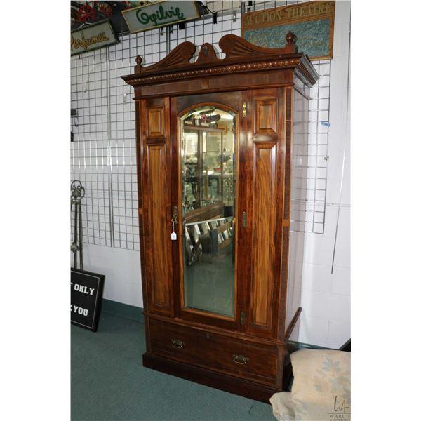 Antique Edwardian single door mahogany wardrobe with single drawer in base, raised panels, bevelled