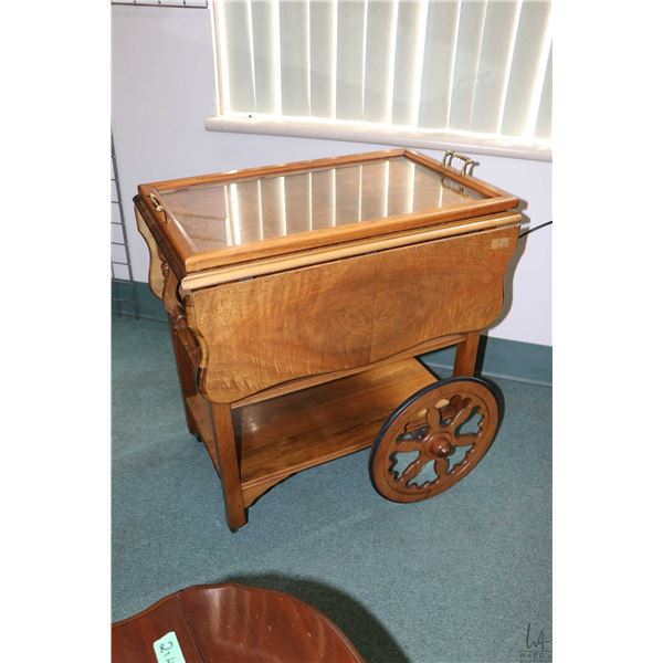 Vintage drop leaf tea wagon with matched grain top and removable drink's tray