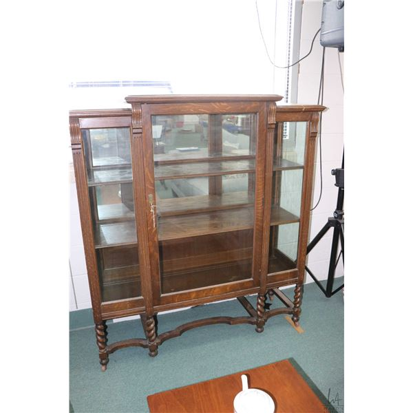 Antique oak single door display cabinet with barley twist supports