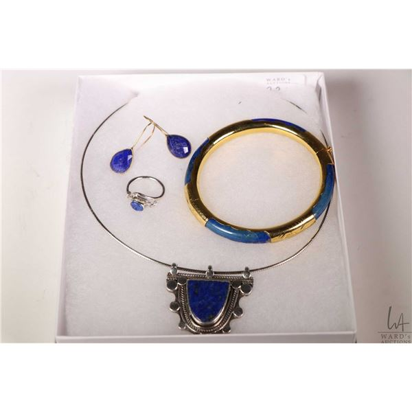 Selection of lapis lazuli jewellery including sterling silver ring, pendant with wire neck lace, gol