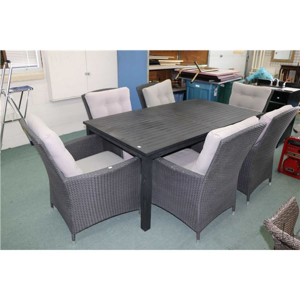 """Quality patio dining suite including a 39"""" X 71"""" table plus 24"""" jack knife leaf and six woven rattan"""